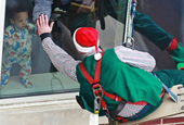 Rappelling Elves Delight Patients in Indiana Hospital